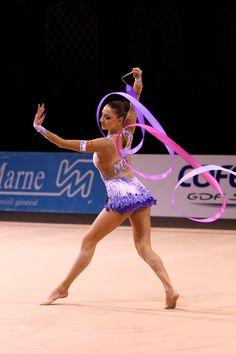 Evgenia Kanaeva of Russia performs with the ribbon apparatus. Photo by Dan Pickard/magicalaction.com