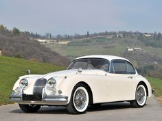 1959 Jaguar XK150 Coupe always a beautiful drive.. if a little twitchy on the rear in the wet ..
