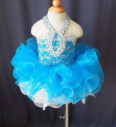 description:  Beautiful National Pageant Dress Made for Lovely Little Princess.  It is a one piece dress.  Bodice made of stretch material and