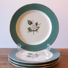 4 Homer Laughlin vintage dinner plates.  by TimeDriftVintage