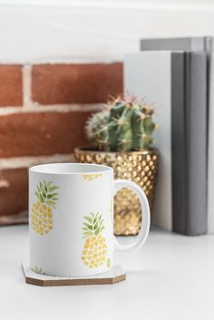 The perfect summer mug for the cabin! Pineapple mug by Wonder Forest on Deny Designs.