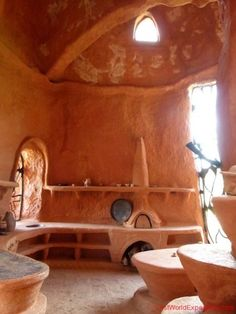 Cob kitchen. <3 that countertop wood-fired oven.: