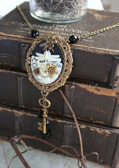 http://www.etsy.com/listing/113316992/midnight-dragonfly-aged-brass-victorian?ref=shop_home_active
