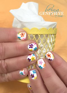 Flowers Galore   Step-by-step tutorial on how to create this cute flower nail art design. This is the perfect manicure for any summer vacation. . .
