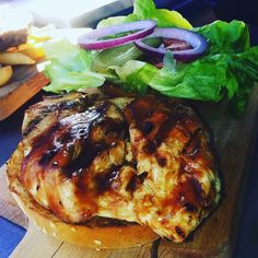 Tuesday lunch is all about that juicy grilled chicken burger  #BondiGrille #ribs #steak #burgers #chicken #moreribs #bbq #yummy #dinner #dinnertime #Coolangatta #TweedHeads #Tweed #Kirra #SnapperRocks #Queensland #Australia #instafood #instagood #instacool #local #smallbusiness #summer #holiday #surf #beach #sun by bondigrille