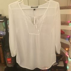 Express Sheer White Top Experess 3/4 length sleeve sheer top. Sequins and draw strings on front. Button sleeves. Very cute over a tank top. Express Tops Blouses
