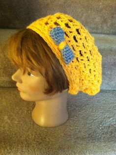 Very bright and very cute orange slouchy hat! A stylish grey bow to top it off! Soft and loose stitches for a comfy fit.