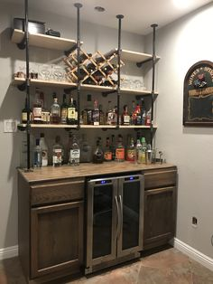 Gas pipe shelves over rustic bar