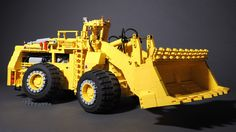 https://flic.kr/p/Qu5SVa | Marathon LeTourneau L-1200 LeTro-Loader | Diesel-electric wheel loader  The prototype featured a 22-cubic-yard bucket and was suited to load 150 to 170 ton haul trucks like the Euclid R-170.  My model in scale 1:28.5 has all the functions of the original:  - All-wheel drive with planetary gear reduction in each wheel hub using two PF XL motors - Articulated steering by means of two linear actuators powered by a PF M motor - Pneumatic lift arm with four-cylinder…