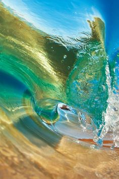 i like how close the sand is, you can see the sun through the water which creates a prism of magnificent colors :) love the blue, green and gold