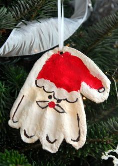 We love this handprint Santa ornament! Salt dough ornaments are a Christmas classic, but this one takes the cake. So adorable!