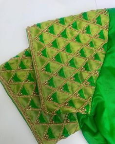 Tissue embossed over silk with cutwork to ive a look. Cutwork Blouse Designs, Wedding Saree Blouse Designs, Simple Blouse Designs, Saree Blouse Neck Designs, Stylish Blouse Design, Hand Work Blouse Design, Aari Work Blouse, Maggam Work Designs, Designer Blouse Patterns
