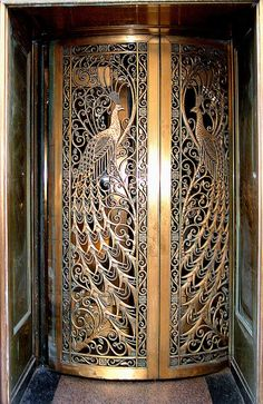 Absolutely jawdroppingly beautiful bronze work. Door to the former C.D. Peacock jewelry store on State Street at Monroe in Downtown Chicago, Illinois.