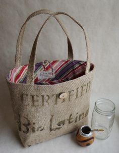 SALE. Upcycled LeAH tote. Everyday bag. Book bag. Burlap coffee sack. Purple pink green rust striped liner.. $52.00, via Etsy.