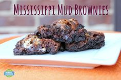 Mississippi Mud Brownies - Ooey, gooey, molten chocolate brownie with melted marshmallows on top of an Oreo crust. What more can you say?!