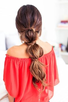 How to get this simple pony: Secure hair into a low ponytail with an elastic. Three inches down from that elastic, tie another and hide it with a small section of hair. Repeat once or twice more depending on the length of your hair.
