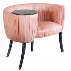 The delicate lines of this occasional chair are created by a signature ruched leather detail. This exquisitely detailed chair has an attached table top and tape...