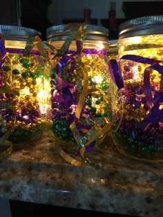 Mardi Gras bead mason jars center pieces using LED string lights