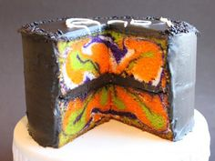 Cut into the cake, and check out the psychedelic mix of orange, green, purple, and white swirls. Get the recipe at Baked By Diane.  RELATED: 21 WIcked Ways to Use Mason Jars This Halloween   - CountryLiving.com