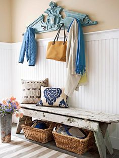 Love the look of these vintage finds - blue pediment with hooks, rustic chippy bench with storage baskets beneath <3