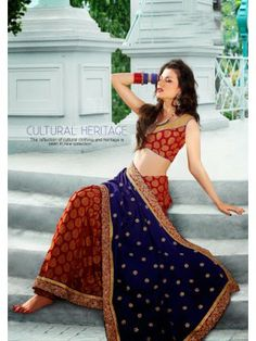 http://www.skbmart.com/vikruti-red-and-navy-blue-jacquard-and-viscose-georgette-saree-dn-23406