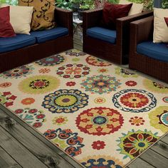 A whimsical array of colors and design, the beige Promise rug is a delightful way to brighten up any room. With a playful paisley pattern in vibrant tones of red and green, this contemporary piece is stain and fade resistant to decorate any setting.
