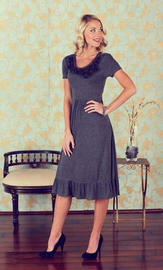 Modest Dress: Embellished Neckline Dress in Grey $44.99    The Emma is an elegant and flirty dress. The neckline is adorned with many beautiful rosettes. The basic short sleeve and the neckline have a lovely chiffon trim, setting this dress apart from the rest. The gathering at the waistband will hide any problem areas, and adds the attractive fullness to the skirt. Topped off with a ruffled hem, the Emma is the recipe for a perfect dress. http://www.jenclothing.com/mi-9009-emma-grey.html