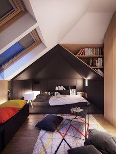 mansarda-arredare-camera-da-letto-tappeto-grafico-cuscini-terra-tavolino-metallo-libreria-legno