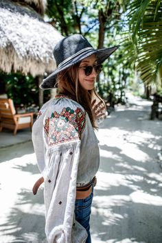 ukrainian embroidery / embroidered shirt outfit styled with parker smith flare jeans by fashion blogger Tanya Litkovska. More on HIDEMYCOAT blog