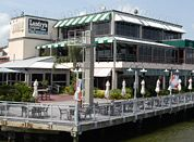 I love to sit at the outside tables at Landry's. It is located where the sailboats pass by to go from the Clear Lake area out into Galveston Bay. It is so relaxing to watch the sailboats while enjoying good food!