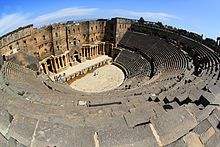 Ancient Roman Theatre of Bosra, Syria. This 2nd C CE theatre is a Unesco World Heritage site. Bosra was incorporated into the Roman Empire in 106 CE, as the capital of the Roman province of Arabia; it was an important stopover on the ancient caravan route to Mecca. Bosra is a major archaeological site, containing ruins from Roman, Byzantine, and Muslim times. Further, Nabataean and Roman monuments, Christian churches, mosques and Madrasas are present within the city.