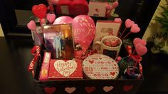 Valentines Basket for my boyfriend!! I got the basket from Michaels-$5.00 I got most of the candy from the dollar store, along with the shredded paper for the bottom of the basket and the stick hearts for decoration. The tin bowl is also from the dollar store:) I will be putting CHOCOLATE COVERED STRAWBERRIES in it!! so excited to give this to him. It was beyond easy and so much fun to make!