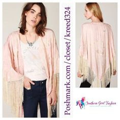 "FREE PEOPLE Jacket Embroidered Fringe Kimono Top One size fits all.  New without tags. *spare button bag still attached* $228.  Color: Light Pink.  Gorgeous embroidered cape with deep v neck.  Flowing fringe hem. Button placket in the front. Viscose.   Measurements: Length: 32"" Sleeve: 20.5""    ❗️ Please - no trades, PP, holds, or Modeling.   ✔️ Reasonable offers considered when submitted using the blue ""offer"" button.    Bundle 2+ items for a 20% discount!    Stop by my closet for even more…"