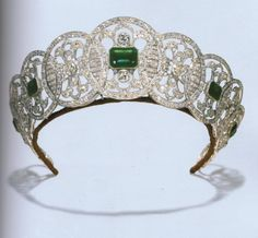 Designed as thirteen graduated openwork panels, set with old-cut diamonds, five of which are centered with rectangular-cut emerald simulants, circa 1910, 44.5 cm. wide, with French assay marks for platinum. An all diamond version is also available.