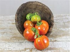 """Turkish Orange Eggplant80 days. This beautiful heirloom comes from Turkey. The 3"""" round fruit are best cooked when they are green to light orange. This variety has very sweet and flavorful flesh. It imparts a strong, rich flavor to any dish. The small plants yield well. This variety is great for ethnic markets. Very ornamental-looking."""