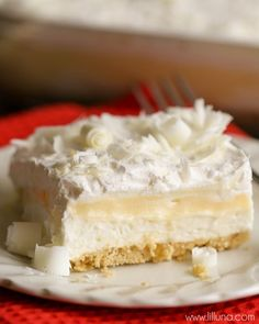 White Chocolate Lasagna - a delicious 4-layer dessert filled with cream cheese, pudding, cool whip, Golden Oreos, White Chocolate curls and more! { lilluna.com }