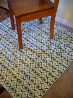 DIY Splat Mat - fabric of your choice, iron-on vinyl coating and voila - crap catcher for under the high chair. Hooray!