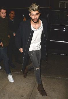 Best Celebrity Street Styles: Style Icon Zayn Malik in an Assymetrical White Tee, Ripped Jeans and Versace Overcoat. Follow rickysturn/mens-casual for more Hot Trends
