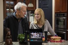 "Co-producer/director Clint Eastwood talks with Laura Linney on the set of ""Sully"", 2016."