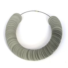 """This necklace SERPE consists of many cardstock circles that are thread on a stainless steel wire witha simple screw clasp. It is sprayed with protective lacquer and splashproof.  Diameter of the disks: 3,2cm (1 1/4"""") Length of the necklace: 42 cm (16 1/2"""")"""