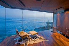Breathtaking interiors featuring the iconic Eames chair - we'll take the chair and the house!