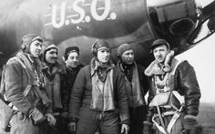 "Walter Cronkite and the aircrew after a mission over Europe on a B-17 with the nose art ""U.S.O."""