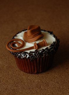 Indiana Jones Cupcake. Doesn't come with a recipe. My new quest is coming up with a Indiana Jones flavored cupcake.