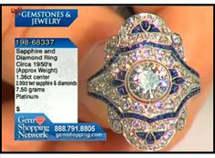 Diamond and sapphire estate ring from our estate jewelry collection. This ring has a wonderful central diamond in an antique platinum setting.