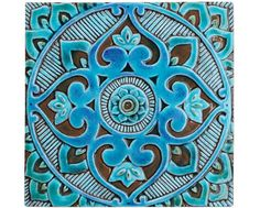 Mandala wall art made from ceramic.    This mandala wall hanging was carved in deep relief and no two pieces are exactly alike making each one truly