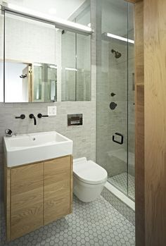 Small Modern Bathroom with Glass Shower Door.
