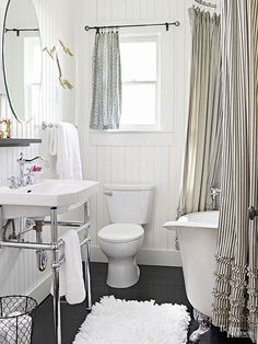 With the fuzzy area rug, fluffy white towels, and flirty ruffled curtain enclosing the footed tub, textiles play an important role in this vintage bathroom's appeal. Neutral Bathroom Colors, Grey Bathroom Tiles, Bathroom Color Schemes, White Bathroom, Small Bathroom, Classic Bathroom, Neutral Colors, Bathroom Canvas, Bathroom Beadboard