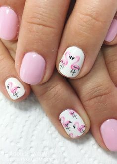 Flamingos summer nail art.These cute birds are the perfect summer nail design. You have to try these adorable pink flamingos this summer! #NailArt #NailDesigns #AprilGolightly