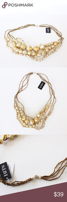 NWT Designer 31 Bits Handmade Gold Tone Necklace Brand new with tags. 31 Bits (brand sold at Nordstrom) Handmade from recycled materials. Beads are covered in gold-tone flecks. Multilayer. Signature 31 bits button clasp closure. Approximate retail price $72.00 31 Bits Jewelry Necklaces