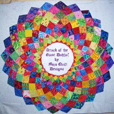 Learn to make a Giant Dahlia quilt! Find the lessons at http://mojoquiltdesigns.wordpress.com/tutorials/free-giant-dahlia-pattern-and-follow-along-instructions/